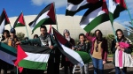Algerians with Palestinian flags stage a protest against U.S. President Donald Trump's decision to recognize Jerusalem as the capital of Israel in Algiers, Algeria, Saturday, Dec. 16, 2017. (AP Photo/Anis Belghoul)