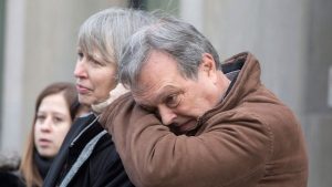 Clayton Babcock, right, stands next to his wife Linda as they listen to crown lawyers speak to the media outside court in Toronto on Saturday, December 16, 2017. Two men accused of killing a young Toronto woman and burning her body have been found guilty of first-degree murder. Dellen Millard and Mark Smich had pleaded not guilty to the charges related to the death of 23-year-old Laura Babcock, whose body has not been found. THE CANADIAN PRESS/Chris Young