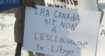 Montrealers rally against the slave trade in Libya on Saturday, Dec. 16, 2017.