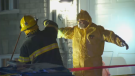 RCMP officers and forensic technicians are decontaminated on the scene of a clandestine drug lab in Chateauguay on the South Shore. (CTV Montreal)