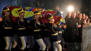 Honor guard soldiers carry the coffin of the late Romanian King Michael during the burial ceremony outside the monastery in Curtea de Arges, 175 kilometers north west of Bucharest, Romania, Saturday, Dec.16, 2017. (Vadim Ghirda/AP Photo)