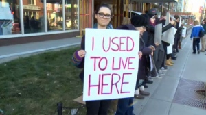 A displaced resident of Kensington Manor delivers her message during Saturday's rally outside the vacated building