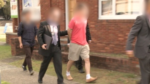In this image released by Australian Federal Police, a 59-year-old man from Sydney is arrested. Police allege the suspect was acting as an economic agent for North Korea from within Australia. (Source: Australian Federal Police)