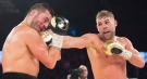 David Lemieux, left, of Laval, Que., takes a right to the jaw from champion Billy Joe Saunders, of Great Britain, during their WBO middleweight championship fight in Laval, Que., on Saturday, December 16, 2017. THE CANADIAN PRESS/Ryan Remiorz