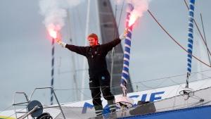 French skipper Francois Gabart lights flares aboard his 30m MACIF trimaran as he celebrates his world record, off Brest harbor, western France, Sunday, Dec. 17, 2017. (AP Photo/Thibault Camus)