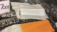 Envelopes found with letters written by Dellen Millard from jail to his girlfriend, Christina Noudga, is shown in this undated police handout photo. THE CANADIAN PRESS/HO - Ontario Courts