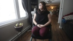 Kristen Hiebert, who almost died in a car crash in January of 2016 is photographed in her home in Boissebain, Man., Thursday November 16, 2017. Almost two years after the crash, the 28-year-old continues to adapt to life without her lower legs – amputated due to frost bite – and continues to work to build a better life for herself and her daughter Avery, now 6. (THE CANADIAN PRESS/John Woods).