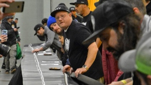 In this Dec. 16, 2017 photo, a 100-foot long joint created by Beantown Greentown, a Boston-based cannabis club, is revealed at the DCU Center in Worcester, Mass. (Chris Christo/Boston Herald via AP)