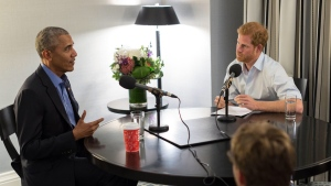 Former U.S. president Barack Obama, left, chats with Prince Harry during an interview on Dec. 17, 2017. (Kensington Palace / Twitter)