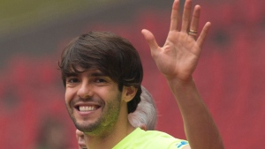 FILE-In this Friday, Oct. 10, 2014 file photo, Brazil's Kaka waves as he arrives for a training session ahead of a friendly match against Argentina at the Bird's Nest National Stadium in Beijing, China. (AP Photo/Ng Han Guan, File)