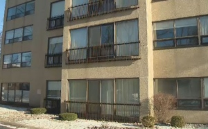 A Halifax woman was hospitalized Saturday night after jumping from a second storey window to escape a fire in her high-rise apartment building.