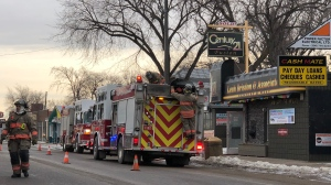 Burning candles are believed to be behind a fire in a building on 33rd St. West on Sunday morning, according to Saskatoon Fire Department officials.