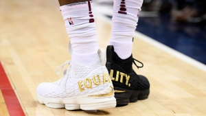 "Cleveland Cavaliers forward LeBron James' shoes are emblazoned with ""EQUALITY"" on both heels during the first half of an NBA basketball game against the Washington Wizards, Sunday, Dec. 17, 2017, in Washington. (AP Photo/Nick Wass)"