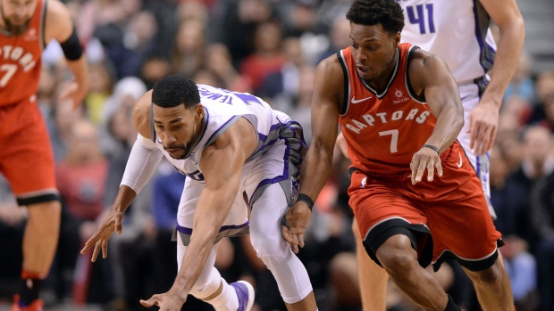 Toronto Raptors guard Kyle Lowry (7) and Sacramento Kings guard Garrett Temple (17) chase down a loose ball during first half NBA basketball action in Toronto on Sunday, December 17, 2017. THE CANADIAN PRESS/Frank Gunn