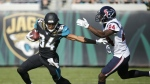 Jacksonville Jaguars wide receiver Keelan Cole runs from Houston Texans cornerback Johnathan Joseph (24) after a reception during the first half of an NFL football game in Jacksonville, Fla. on Sunday, Dec. 17, 2017. (AP Photo/Stephen B. Morton)