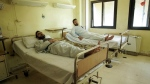 Injured Syrian army soldiers rest in their beds at a hospital in the city of Deir el-Zour, Syria, Friday, Sept. 15, 2017. (AP Photo)