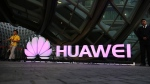 An illuminated logo for Huawei in Beijing, China on May 26, 2016. (Mark Schiefelbein / AP)