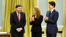 Julie Payette, Governor General of Canada, and Prime Minister Justin Trudeau applaud following the swearing in of the new Chief Justice of Canada, Richard Wagner during a ceremony at Rideau Hall in Ottawa on Monday, Dec. 18, 2017. THE CANADIAN PRESS/Sean Kilpatrick