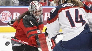 Team Canada goalie Shannon Szabados (1) makes the save as Team USA's Brianna Decker (14) looks for the rebound in Edmonton, on Dec. 17, 2017. (Jason Franson / THE CANADIAN PRESS)