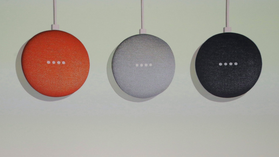 Three colours of the Google Home Mini are shown at a Google event at the SFJAZZ Center in San Francisco, Wednesday, Oct. 4, 2017. (AP Photo/Jeff Chiu)