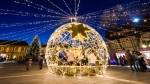The Christmas lights and decorations herald the oncoming seasonal celebrations at the Dobo square in Eger, about 127 kms northeast of Budapest, Hungary, Monday, Nov. 27, 2017. Christmas market stalls and bright lights attract crowds of visitors to the festive scene. (Peter Komka / MTI via AP)