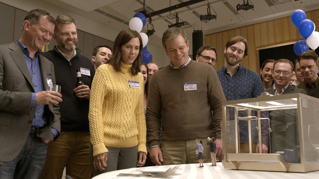 """In this image released by Paramount Pictures, Kristen Wiig, center left, and Matt Damon, center right, appear in a scene from """"Downsizing."""" (Paramount Pictures via AP)"""