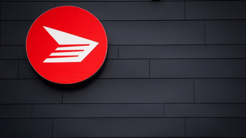 The Canada Post logo is seen on the outside the company's Pacific Processing Centre, in Richmond, B.C., on Thursday June 1, 2017. (Darryl Dyck / THE CANADIAN PRESS)