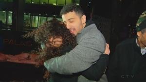 Sabrine Djermane and El Madhi Jamali hug after being released from custody on Dec. 19, 2017