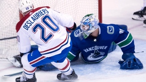 Montreal Canadiens left wing Nicolas Deslauriers (20) sends a shot past Vancouver Canucks goalie Anders Nilsson (31) during second period NHL action in Vancouver, Tuesday, Dec. 19, 2017. THE CANADIAN PRESS/Jonathan Hayward
