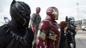 "From left, Chadwick Boseman as Panther, Paul Bettany as Vision, Robert Downey Jr. as Iron Man, Scarlett Johansson as Natasha Romanoff, and Don Cheadle as War Machine in a scene from ""Marvel's Captain America: Civil War."" (Disney Marvel via AP, File)"