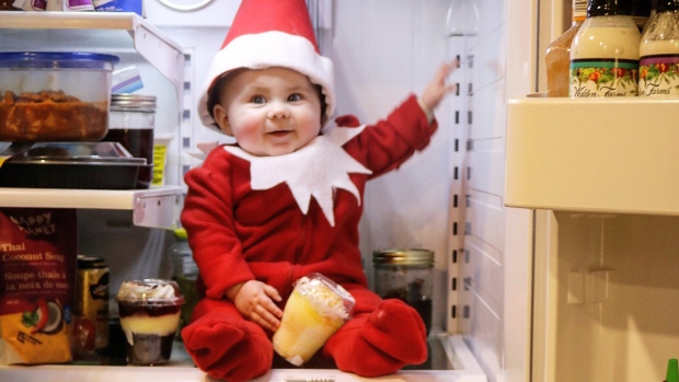 Baby elf on a shelf having fun-filled holidays