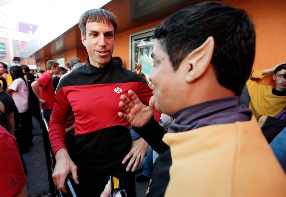 Two Star Trek fans talk while waiting in line to see the first public showing of