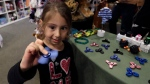 Doctors say that quality control for fidget spinners were lacking, creating choking hazards for children. (AP / Carlos Osorio)
