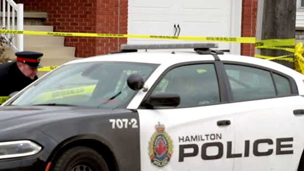 Hamilton police are seen investigating after a fatal incident took place at a residence on Wednesday.