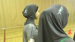 Students model hijabs with the Ecole River Heights School logo. (Sarah Plowman/CTV News)