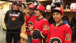 Defenceman Travis Hamonic treated the family to an all-expenses-paid visit, including a game between the Flames and the Nashville Predators last weekend.
