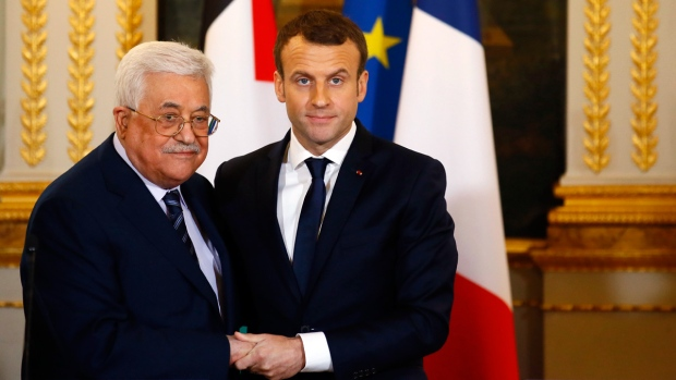 French President Emmanuel Macron, right, shakes hands with Palestinian President Mahmoud Abbas during a joint press conference at the Elysee Palace after their talks in Paris, Friday, Dec. 22, 2017.  (AP Photo/Francois Mori)