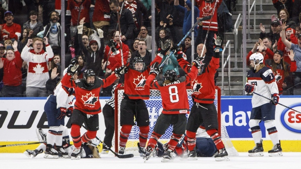 Team Canada celebrates a game-winning goal