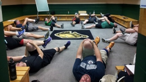 Men participating in the University of Western Ontario's Hockey Fans In Training program, funded by the Movember Foundation, stretch in the London Knights locker room in this undated handout photo.  THE CANADIAN PRESS/HO - Hockey Fans in Training