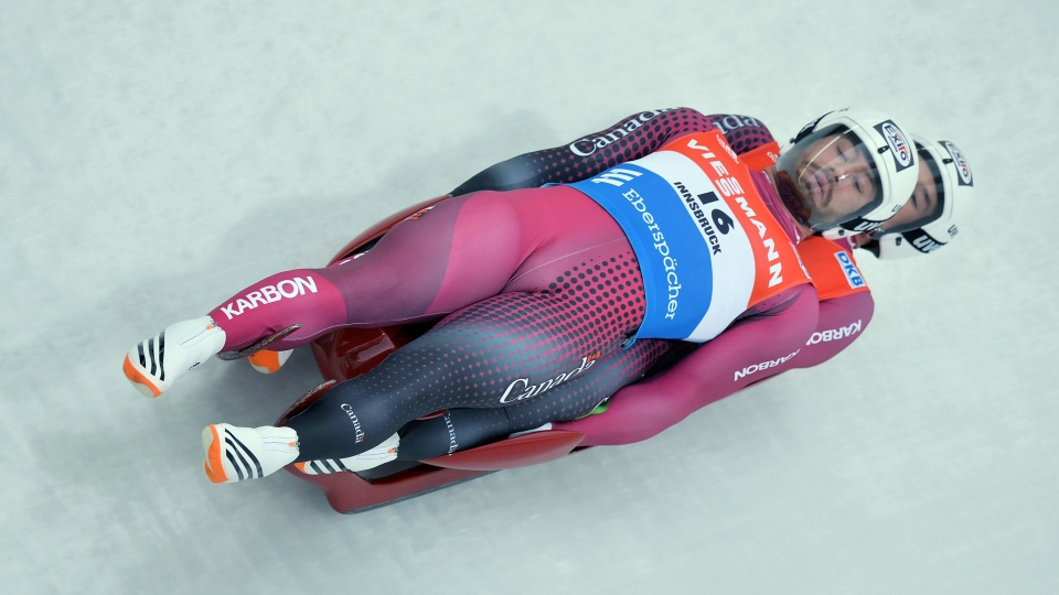 Tristan Walker and Justin Snith from Canada speed down the course during their first run of the men's doubles luge World Cup race in Innsbruck Igls, Austria, on Saturday, Nov. 28, 2015. (AP Photo/Kerstin Joensson)