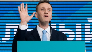 Russian opposition leader Alexei Navalny gestures while speaking during his supporters' meeting that nominated him for the presidential election race in Moscow, Russia, Sunday, Dec. 24, 2017.  (AP Photo/Pavel Golovkin)