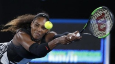 Serena Williams reaches for a backhand