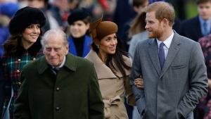 Prince Harry and his fiancee Meghan Markle arrive