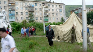 Rescue workers set up tents in the small port town of Nevelsk in Sakhalin island at Russian far east, just north of Japan, on Thursday, Aug. 2, 2007, following a strong earthquake. (Sovetsky Sakhalin, Pavel Ryabchikov/AP Photo)