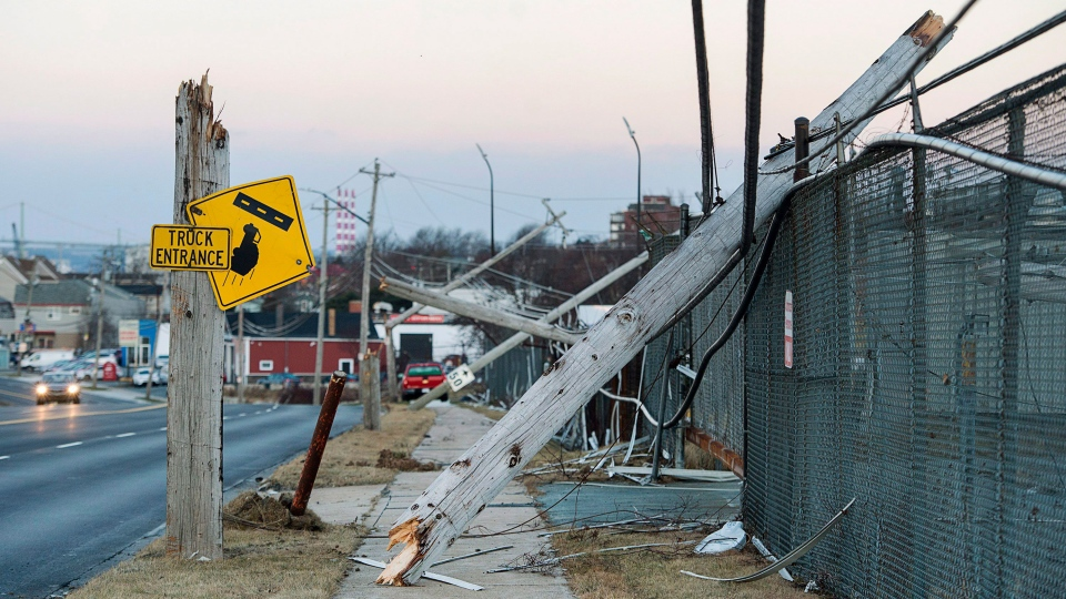 Damaged power lines are seen in Dartmouth, N.S., on Tuesday, Dec. 26, 2017. (Andrew Vaughan/THE CANADIAN PRESS)