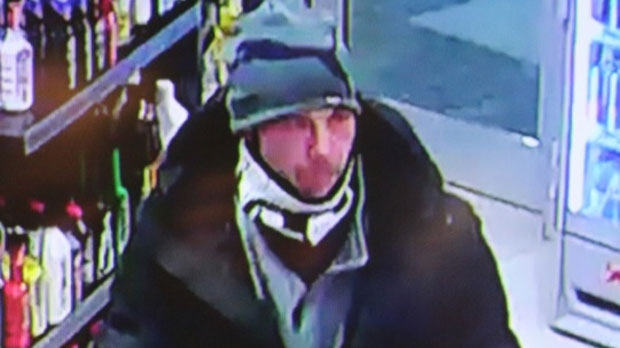 Video surveillance shows the suspect wearing a black coat over a grey jacket, light-coloured pants, black with white running shoes, and a grey beanie-style, Puma toque.