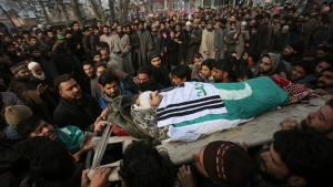 Kashmiri Muslims carry the body of Noor Mohammed, a top rebel commander during his funeral procession at Aripal, 49 kilometres south of Srinagar Indian controlled Kashmir, Tuesday, Dec. 26, 2017. Indian troops killed a rebel commander in a gunfight early Tuesday in southern Samboora village in Indian-held Kashmir. (AP / Mukhtar Khan)