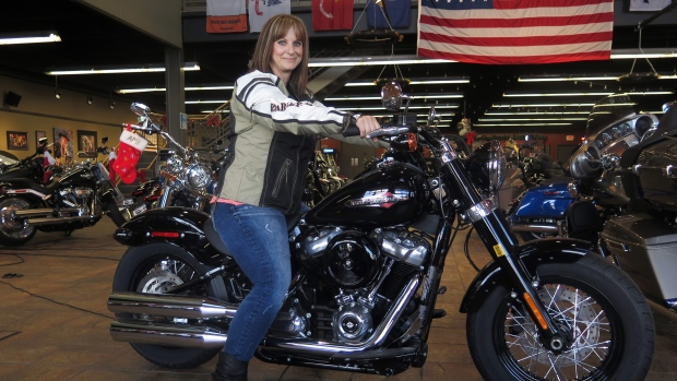 Terri Meehan poses on a 2018 Harley Softail Slim