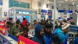People line up at Best Buy in Saskatoon on Dec. 26, 2017