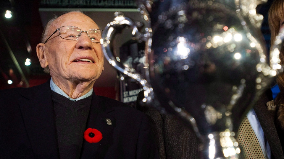 Johnny Bower is seen next to the Memorial Cup as he takes part in a new exhibit dedicated to First World War and Second World War veterans at the Hockey Hall of Fame in Toronto on Monday, November 10, 2014. (THE CANADIAN PRESS/Nathan Denette)